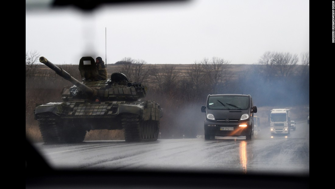 A pro-Russian rebel tank rolls along a road near Donetsk on Monday, February 2.