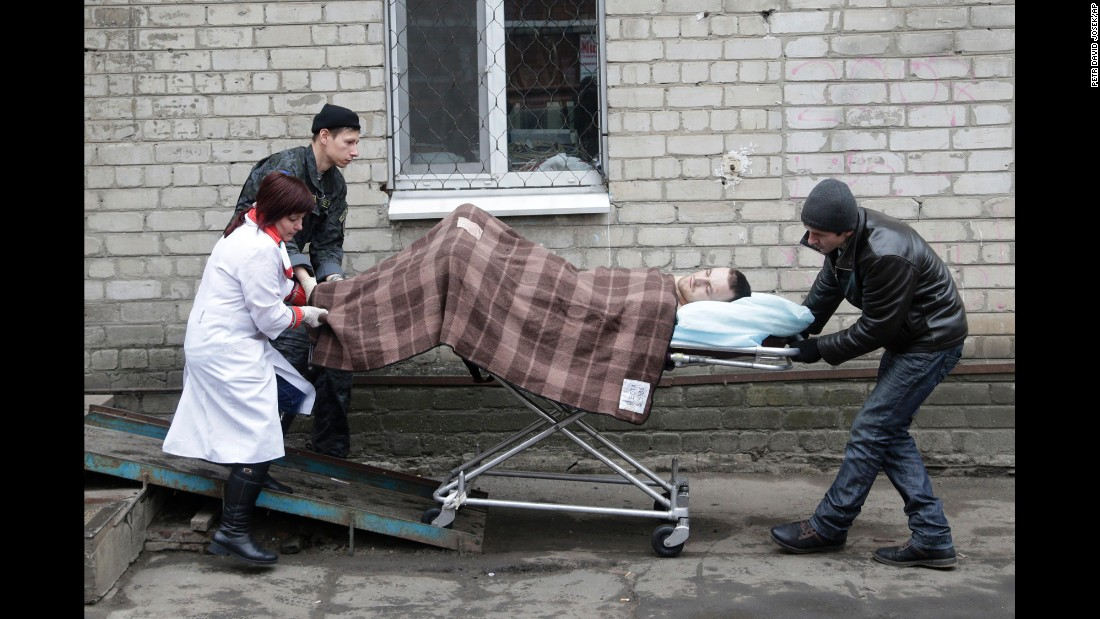 An injured soldier is wheeled on a stretcher outside of a hospital in Artemivsk, Ukraine, on January 30.