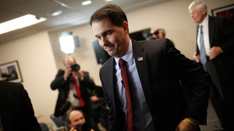 WASHINGTON, DC - JANUARY 30: Wisconsin Governor Scott Walker departs after speaking at the American Action Forum January 30, 2015 in Washington, DC. Earlier in the week Walker announced the formation of #39;Our American Revival#39;, a new committee designed to explore the option of a presidential bid in 2016. (Photo by Win McNamee/Getty Images)