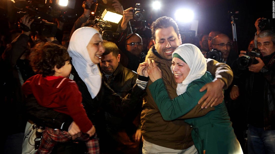 A man comforts al-Kasasbeh's wife during the protest in front of the royal palace on January 28.
