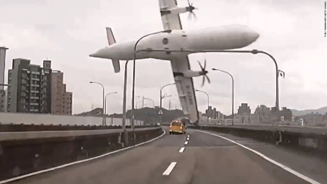 TransAsia Airways Flight GE235 clips a bridge in Taipei, Taiwan, shortly after takeoff Wednesday, February 4, in this still image taken from video. There were 58 passengers on board the ATR 72 twin-engine turboprop airplane that plunged into the Keelung River.