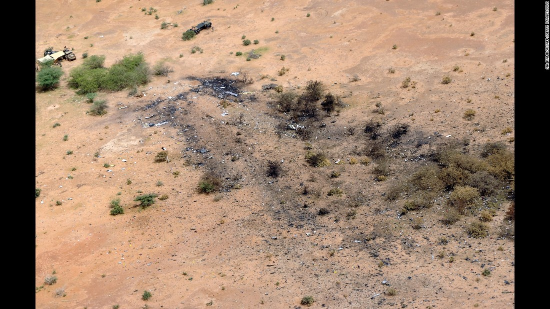 "The crash site of Air Algerie Flight AH 5017 in Mali is visible from above on July 26. <a href=""http://www.cnn.com/2014/07/25/world/africa/air-algerie-crash/"">After the crash, French President François Hollande</a> said the jet was found in a ""disintegrated state."" He said there were no survivors."