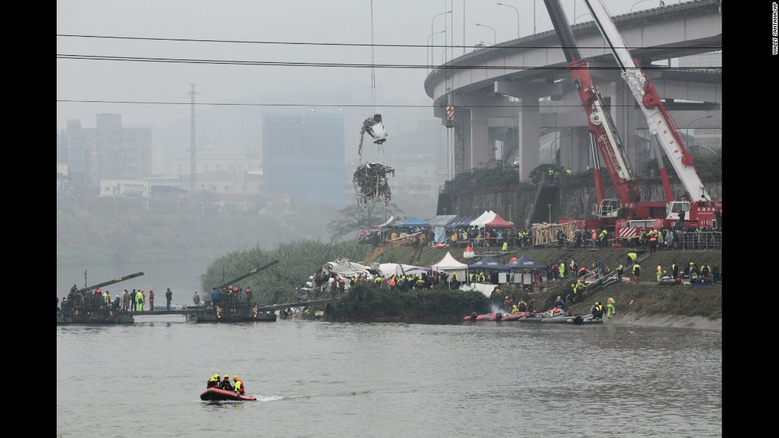 A crane lifts part of the wreckage at the crash site in Taipei on Thursday, February 5.