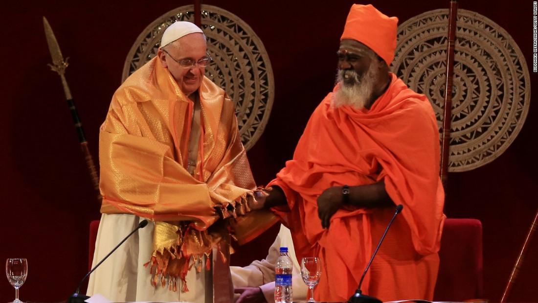 Hindu priest Kurakkal SivaSri T. Mahadeva presents a shawl to Pope Francis in Colombo, Sri Lanka, on Tuesday, January 13.