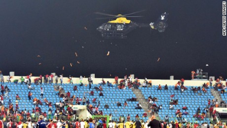 A police helicopter flies over the statdium during an interruption of the 2015 African Cup of Nations semi-final football match between Equatorial Guinea and Ghana in Malabo, on February 5, 2015. Play was halted eight minutes from time in the Africa Cup of Nations semi-final between hosts Equatorial Guinea and Ghana when missiles were thrown on the pitch. AFP PHOTO / ISSOUF SANOGOISSOUF SANOGO/AFP/Getty Images