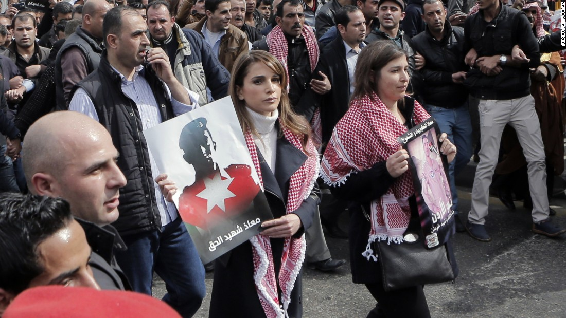 Jordanian Queen Rania, center, holds a placard during a demonstration in Amman, Jordan, on Friday, February 6, after the death of pilot Moath al-Kasasbeh by ISIS. Al-Kasasbeh was burned alive in a video recently released by ISIS militants.