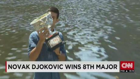 exp djokovic celebrates aus open win_00002001
