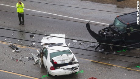 A Los Angeles County Sheriff's department investigates the scene of a collision involving three vehicles in Malibu, Calif. on Saturday, Feb. 7, 2015. Officials said former Olympian Bruce Jenner was a passenger in one of the cars involved in the Pacific Coast Highway crash that killed one person. Jenner's publicist, Alan Nierob, says Jenner was unhurt. (AP Photo/Ringo H.W. Chiu)