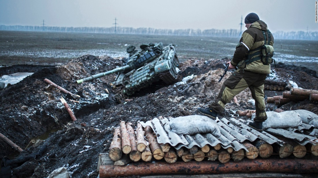 A pro-Russian rebel guards a former Ukrainian army checkpoint outside Vuhlehirsk on Thursday, February 5.