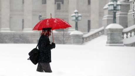 A pedestrian walks through morning snow in Albany, New York, on February 9.