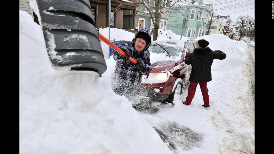 Rich and Kathy Melvin shovel out their car in front of their house in Somerville, Massachusetts, on Tuesday, February 10.