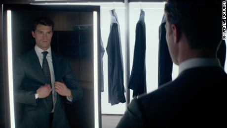 Jamie dornan as christian grey dons one of many custom made suits