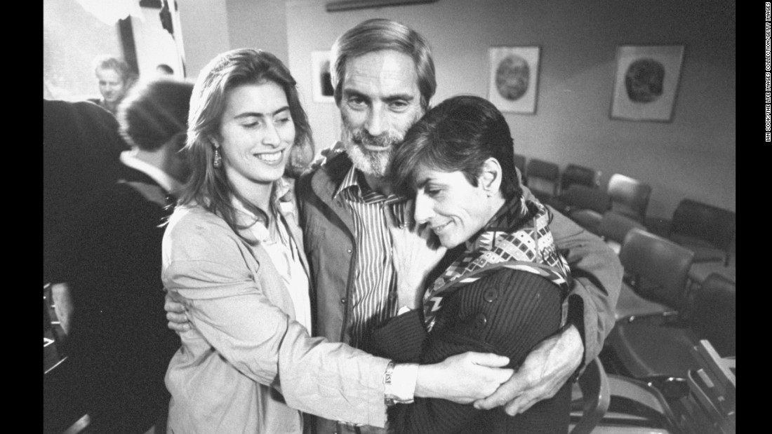 Simon with his wife, Françoise, and daughter Tanya at the press conference after he was freed.