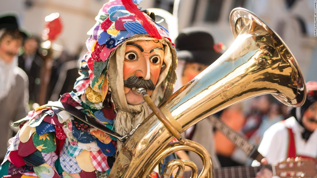 A performer wearing a wooden mask takes part in the annual Carnival parade in Mittenwald, Germany, on February 12.