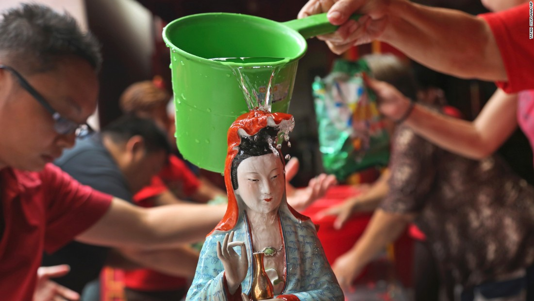 A Chinese god statue is cleaned at a temple in Jakarta, Indonesia, on February 12.