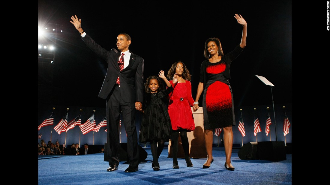 Obama stands on stage in Chicago, Illinois, with his family after defeating Republican presidential candidate John McCain on November 4, 2008.