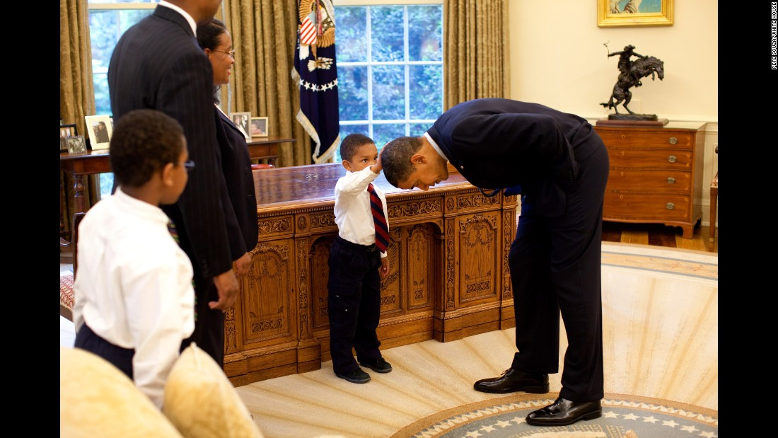 "Obama bends over so the son of a White House staff member can pat his head during a visit to the Oval Office in May 2009. The boy <a href=""http://ift.tt/1Brw4lc; target=""_blank"">wanted to know </a>if Obama's hair felt like his."