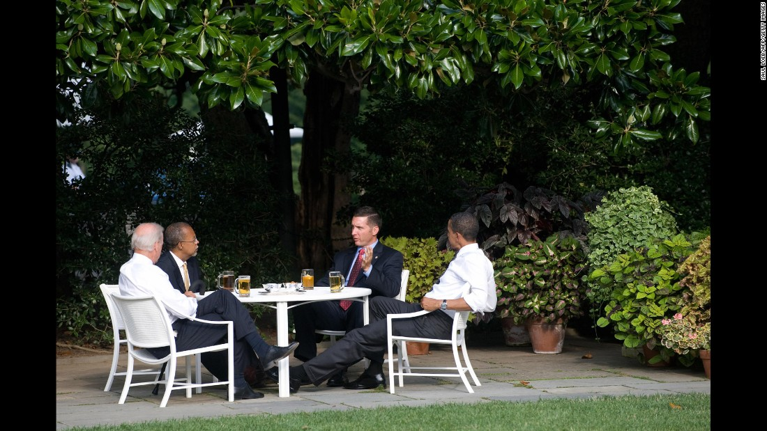 "Police Sgt. James Crowley, second right, of Cambridge, Massachusetts, speaks with Harvard Professor Henry Louis Gates Jr., second left, alongside Obama and Biden as they share beers on the South Lawn of the White House in July 2009. In an effort to curb controversy, the so-called ""Beer Summit,"" was held after Crowley arrested Gates at his own home which sparked tensions and racial furor."