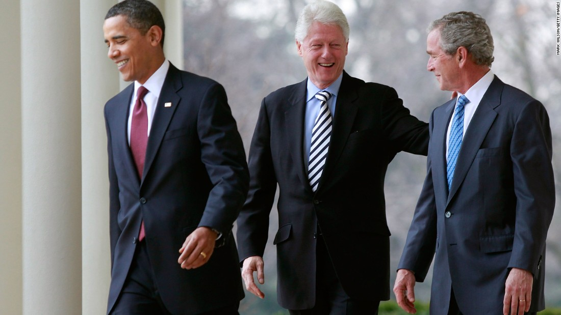 Presidents Obama, Clinton, and Bush walk to the Rose Garden to speak about relief efforts for earthquake-stricken Haiti in January 2010.