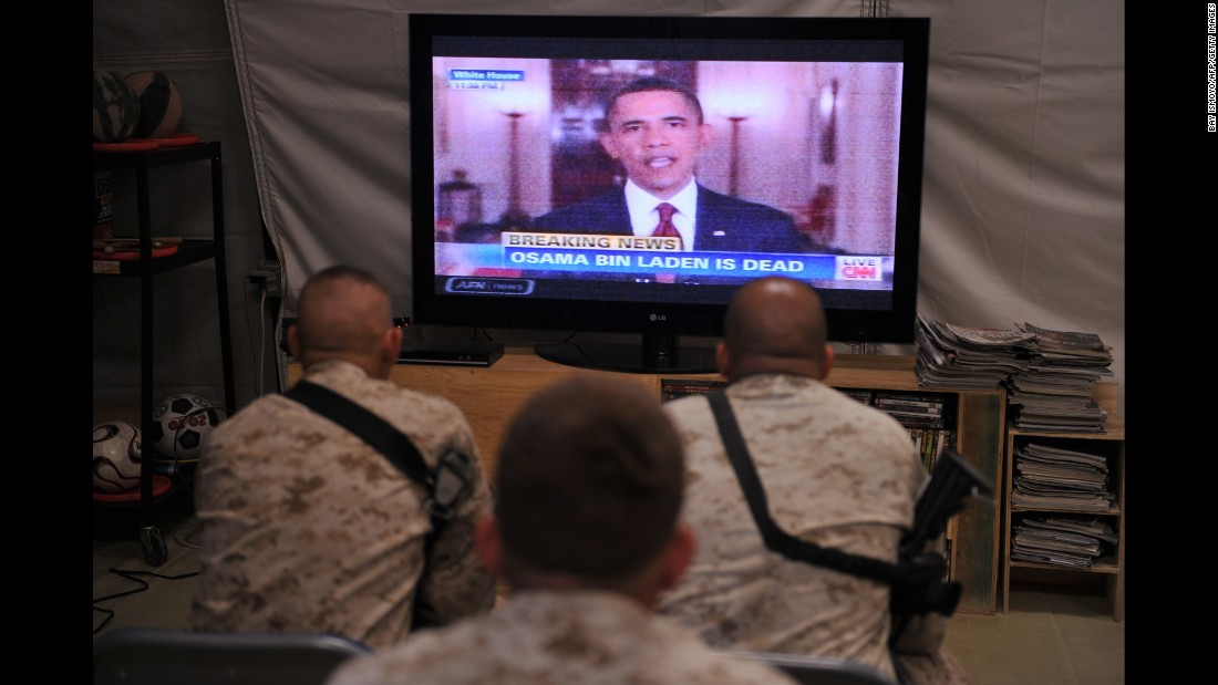 U.S. Marines of Regiment Combat Team 1 watch from Camp Dwyer in Afghanistan as Obama announces the death of Osama bin Laden on May 2, 2011.