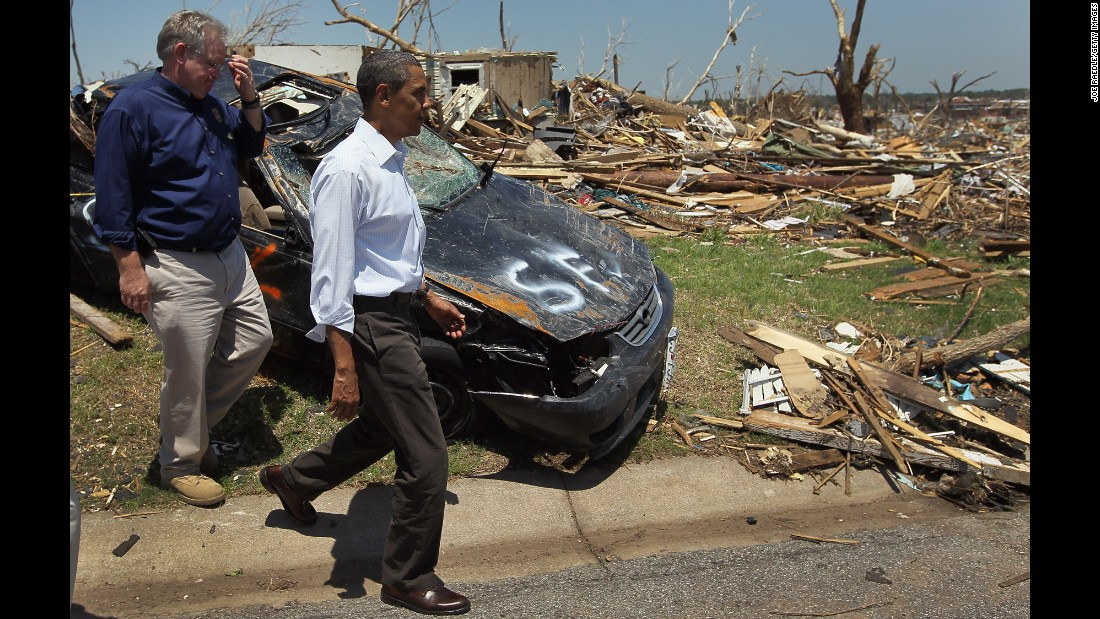 Obama and Missouri Gov. Jay Nixon walk together in May 2011 during a tour of the devastation of Joplin, Missouri, after it was hit by tornado with winds over 200 mph.