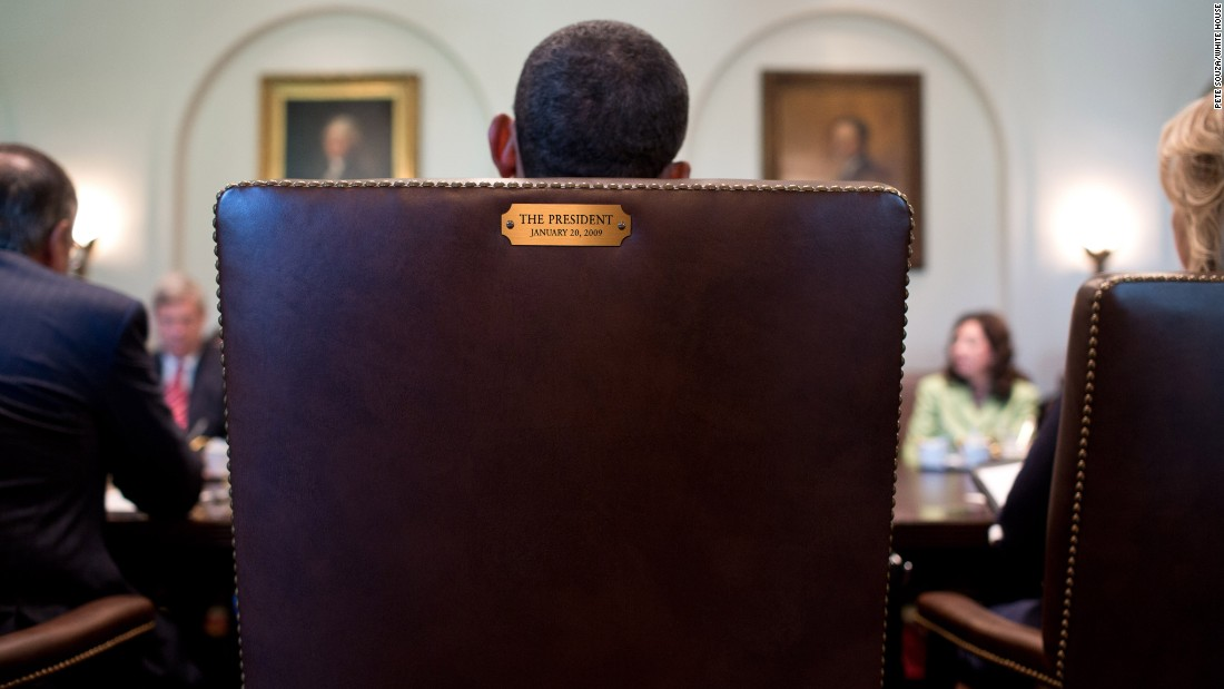 "Obama sits in his chair during a Cabinet meeting in the Cabinet Room in July 2012. This image was tweeted by his official Twitter account in August 2012 in response to <a href=""http://www.cnn.com/2012/08/31/politics/eastwood-speech/"" target=""_blank"">Clint Eastwood's ""empty chair"" speech</a> at the Republican National Convention. The tweet simply said, ""This seat's taken."""