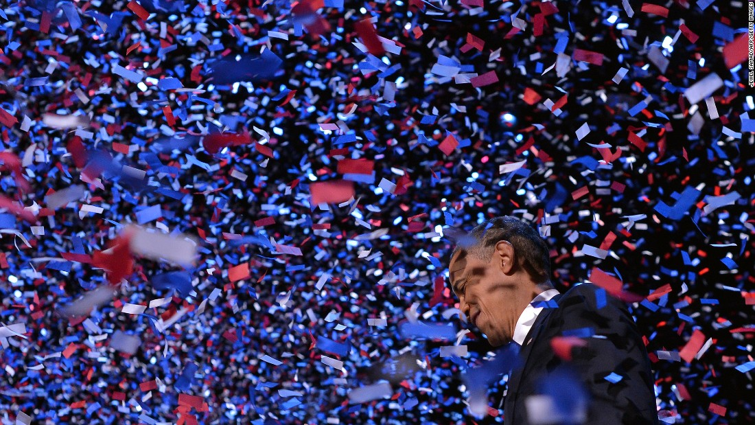 Obama celebrates on stage in Chicago after defeating Romney on Election Day November 6, 2012.