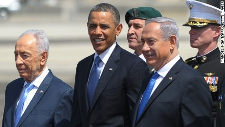 Israeli President Shimon Peres, left, and Prime Minister Benjamin Netanyahu, right, stand with Obama during an arrival ceremony for Obama at Ben Gurion International Airport in Tel Aviv, Israel, in March 2013.
