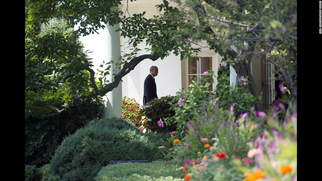 Obama walks to the Oval Office on August 7, 2014, the same day he announced the beginning of air strikes on ISIS.
