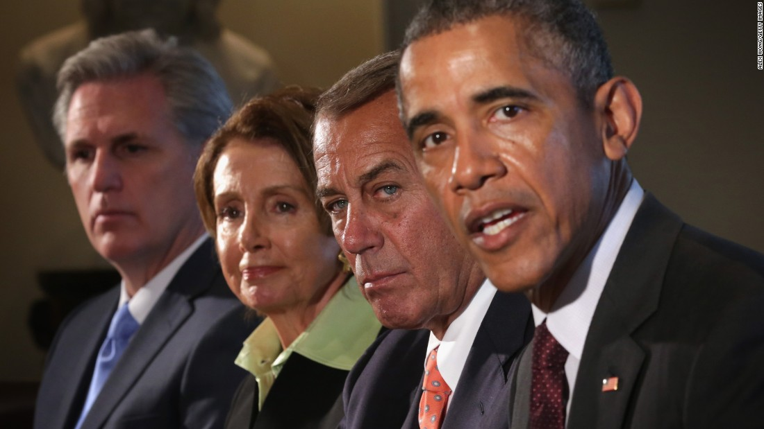 From left, House Majority Leader Kevin McCarthy, House Minority Leader Nancy Pelosi and House Speaker John Boehner listen as Obama speaks during a meeting in the Cabinet Room of the White House on January 13, 2015.