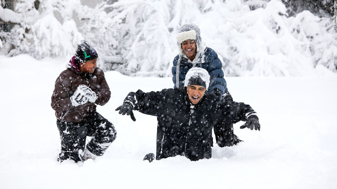 First daughters Sasha and Malia Obama play in the snow with their father in the Rose Garden during a snowstorm that hit Washington in February 2010.
