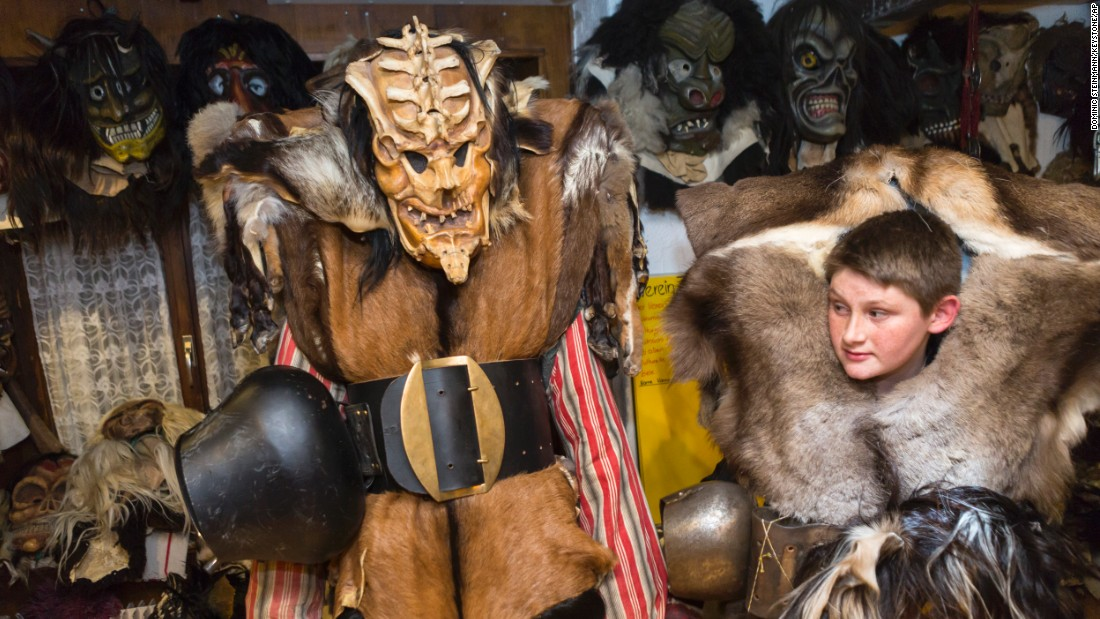 Carnival participants don wooden masks and animal furs to scare residents in the Swiss village of Blatten on February 12.