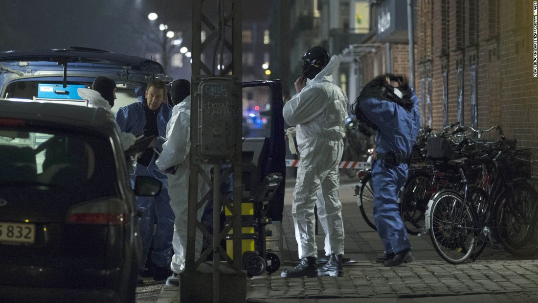 Forensic officers confer near the scene of a shooting Saturday, February 14, in Copenhagen, Denmark.