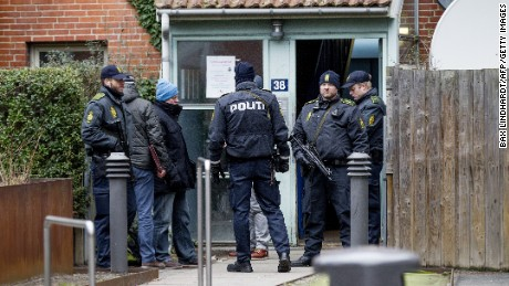Danish police search an apartment in Copenhagen, Denmark on February 15.