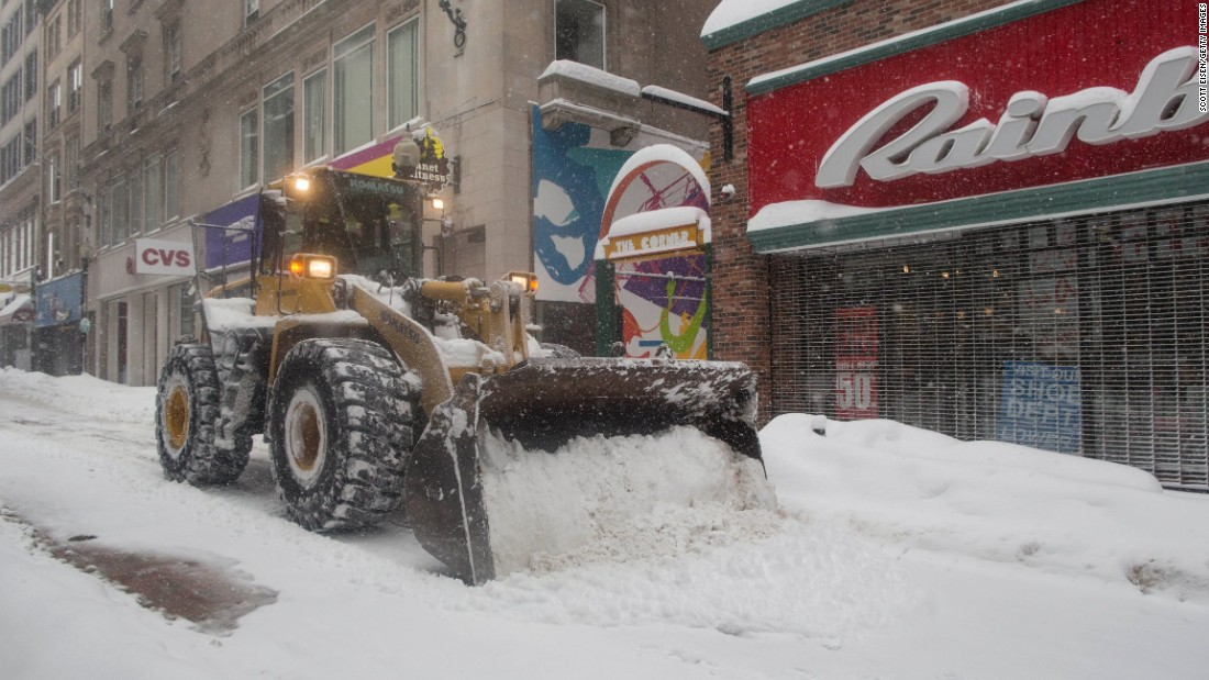Heavy machinery is used to plow the Downtown Crossing area of Boston on February 15, after a winter storm dropped over a foot of snow on the city.