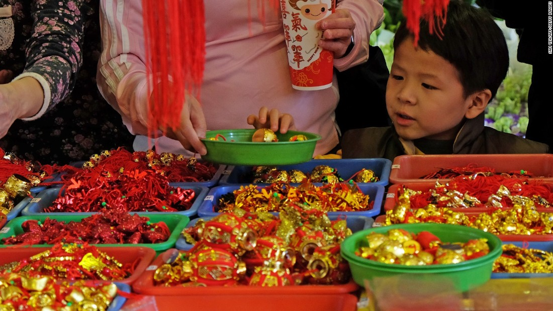 A boy picks a lucky amulet on February 14 at a traditional flower market in Taipei, Taiwan, where Taiwanese shop for their home decorations to welcome the upcoming Lunar New Year.