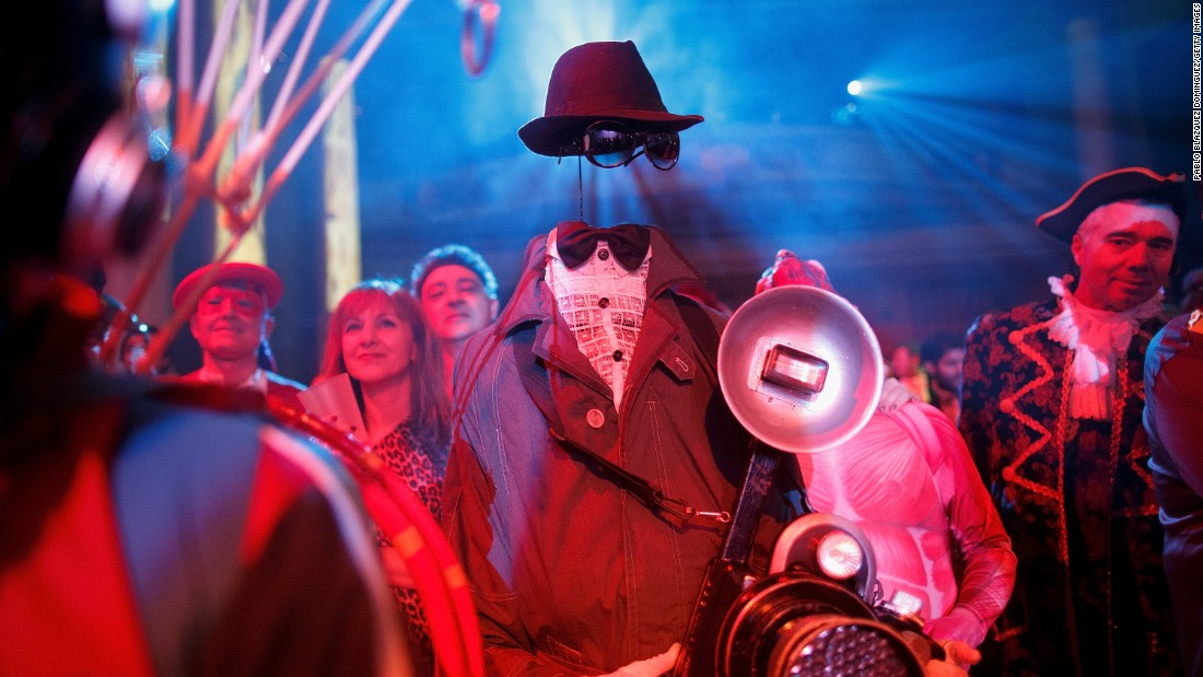 Revelers enjoy a costume party in Madrid on February 15.