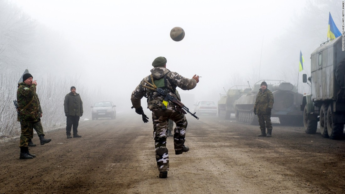 Ukrainian servicemen play with a soccer ball on a road between Svitlodarsk and Debaltseve on February 15.