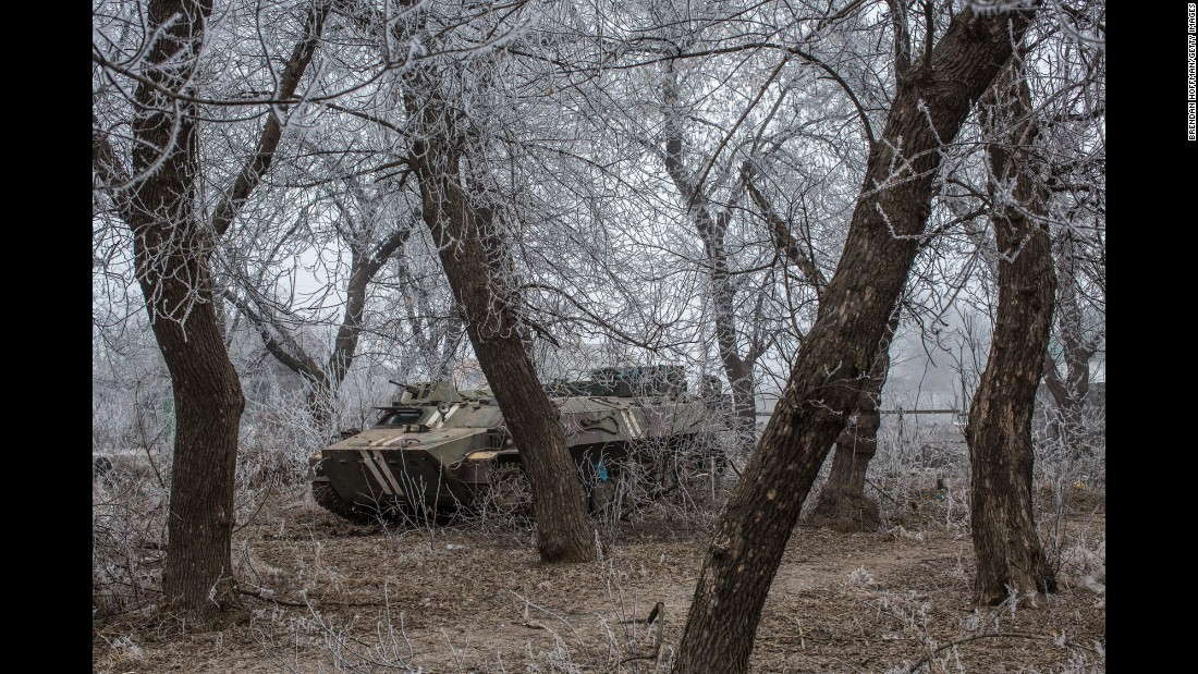 A Ukrainian military vehicle is parked among trees along the road to Debaltseve on February 15.