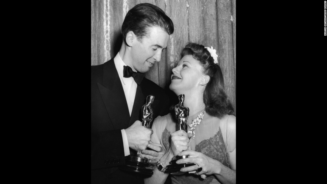"After losing the Oscar a year earlier for his iconic role in ""Mr. Smith Goes to Washington,"" James Stewart received the award playing a reporter who falls for Katharine Hepburn in ""The Philadelphia Story."" Stewart and best actress winner Ginger Rogers celebrate their wins at the ceremony held in 1941."