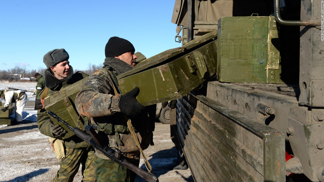 """Pro-Russian rebels load the ammunition onto a truck. <a href=""""http://cnn.com/2015/02/18/europe/ukraine-conflict/"""">The Organization for Security and Cooperation in Europe, </a>which is tasked with monitoring the ceasefire and a supposed withdrawal of heavy weapons, has not been able to gain access to Debaltseve because of the continued conflict."""