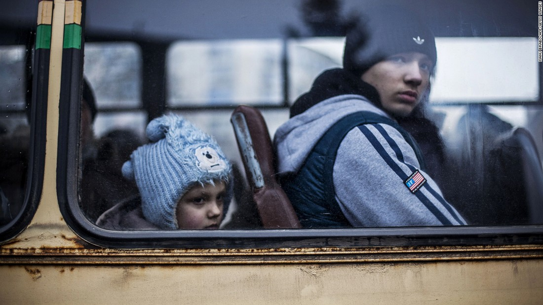 """Ukrainian children sit in a bus before fleeing Debaltseve, in the Donetsk region, on February 3, 2015. <a href=""""http://cnn.com/2015/02/18/europe/ukraine-conflict/"""">Ukraine's military said Wednesday </a>that 80% of Ukrainian armed forces have now pulled out of a strategic railroad hub that's been the focus of bitter fighting with pro-Russian separatists."""
