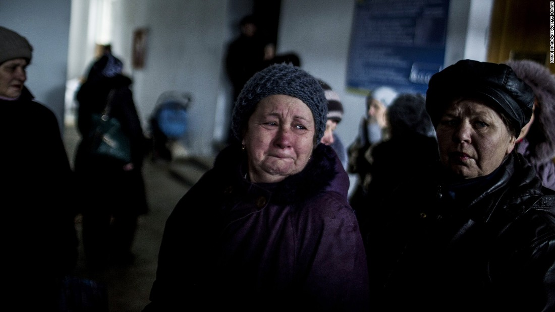 """A Ukrainian woman cries in an administration building before taking a bus to flee her town in Debaltseve. <a href=""""http://cnn.com/2015/02/18/europe/ukraine-conflict/"""">Continued conflict there has undermined a truce</a> that apparently went into effect Sunday, raising concerns it is all but dead."""