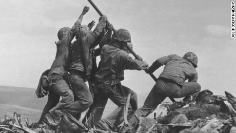 U.S. Marines of the 28th Regiment, 5th Division, raise the American flag atop Mt. Suribachi, Iwo Jima, on Feb. 23, 1945. Strategically located only 660 miles from Tokyo, the Pacific island became the site of one of the bloodiest, most famous battles of World War II against Japan.