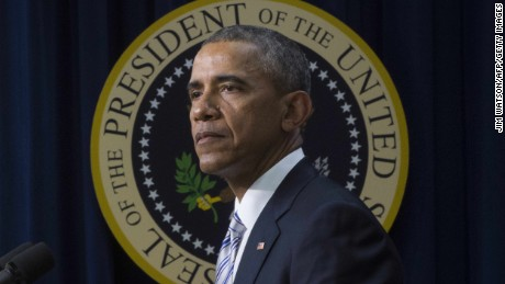 """US President Barack Obama delivers remarks on countering violent extremism in Washington, DC, February 18, 2015. Obama urged Western and Muslim leaders to unite to defeat the """"false promises of extremism, saying they must jointly reject the premise that jihadist groups represent Islam.   AFP PHOTO/JIM WATSON        (Photo credit should read JIM WATSON/AFP/Getty Images)"""