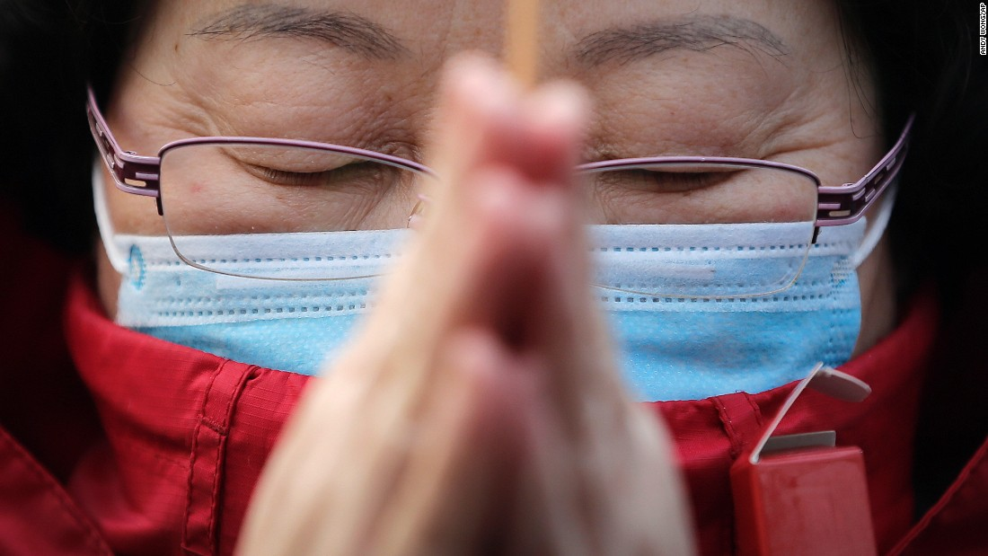 A woman prays in Beijing on February 19.