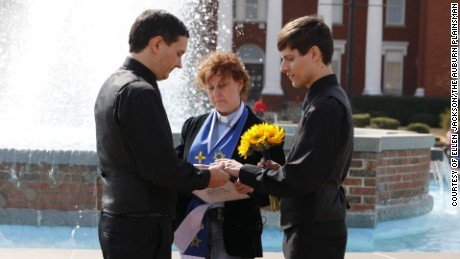 Shawn Williams, 29, left, and Justin Lewis, 28, right, are married by pagan minister Angela Farmer on February 9, at the Lee County Courthouse in Alabama. Williams and Lewis reside in Salem, Alabama. February 9 was the first day of leg an same sex marriage in Alabama.
