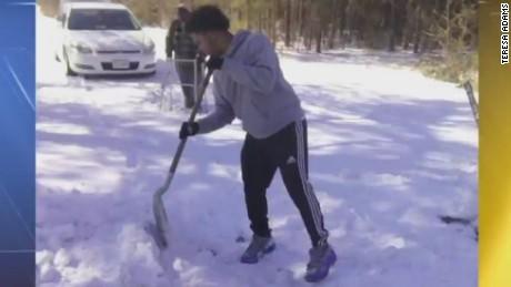 pkg virginia teen helps elderly man shovel_00005310.jpg