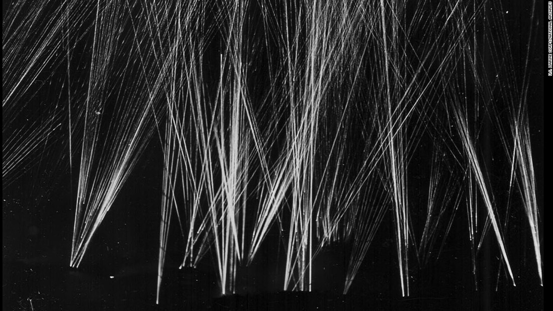 U.S. anti-aircraft tracers light the sky over Iwo Jima as American forces repel a Japanese air attack.