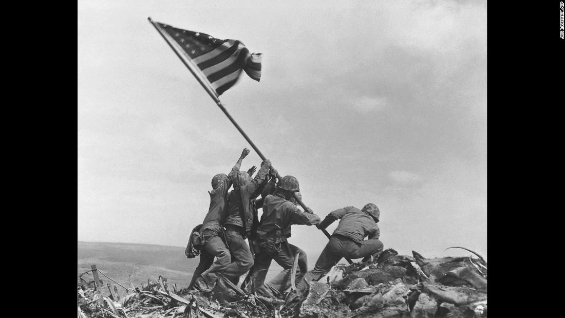 U.S. Marines raise the American flag atop Mount Suribachi on February 23, 1945.